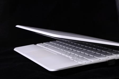 netbook: White netbook on black background Stock Photo