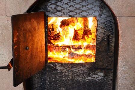 Wood fire in an stone stove Stock Photo