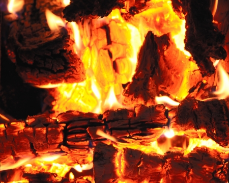 Firewood burning in a fireplace closeup