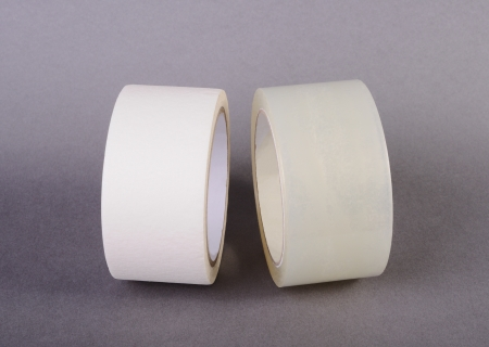 Rolls of tape on gray background Stock Photo