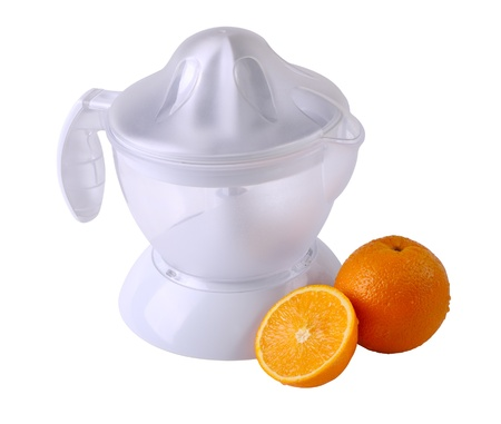 Fruit juicer and oranges isolated on white photo