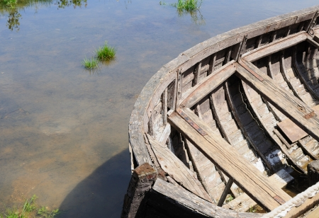Old wooden boat at an edge of the river
