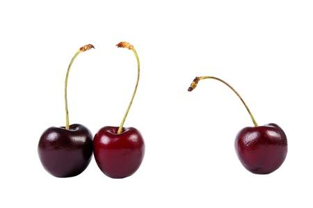 third wheel: Three sweet cherries isolated on white Stock Photo