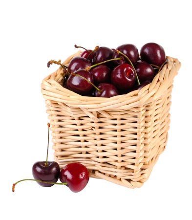 Sweet cherries  in a basket isolated on white