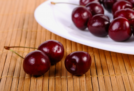 Sweet cherries on white plate