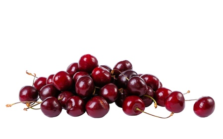 Heap of sweet cherries isolated on white