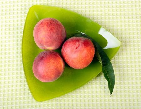 Three peaches on a triangular plate