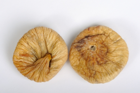 Dried figs on white background closeup