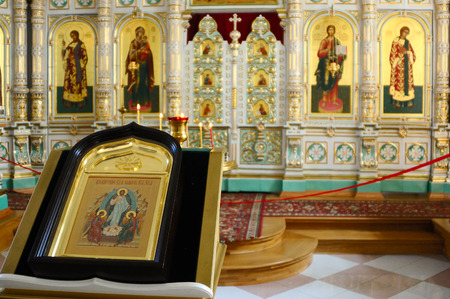 iconostasis: Valaam Island, Karelia, Russia - June 12, 2014: Christian Church of the Resurrection monastery, consecrated in honor of the Resurrection of Christ. Extraordinary light, airy, porcelain iconostasis is framed in gold.