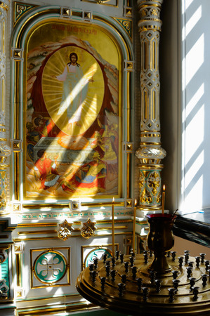 iconostasis: Valaam Island, Karelia, Russia - June 12, 2014: Fragment of earthenware iconostasis with icons of Christ. Extraordinary light, airy, porcelain iconostasis is framed in gold.