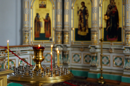 iconostasis: Valaam Island, Karelia, Russia - June 12, 2014: The lamp and candles in the Christian Church of the Resurrection monastery, consecrated in honor of the Resurrection of Christ. Extraordinary light, airy, porcelain iconostasis is framed in gold. Editorial
