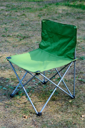 Green folding chair for camping and outdoor use