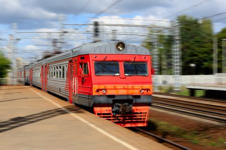 arrives: Train arrives at the platform Stock Photo