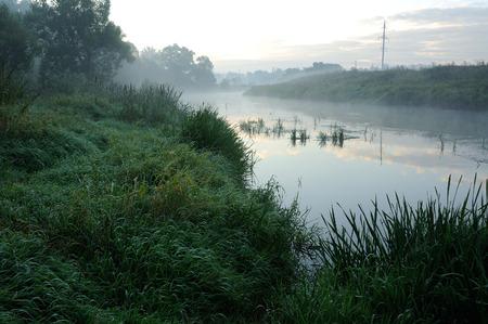 Sunrise and mist on beautiful river