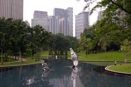 marx: Kuala Lumpur, Malaysia - November 5, 2014: Pond in in the KLCC Park in Kuala Lumpur, Malaysia. This city park was designed by Brazilian architect Roberto Burle Marx. Editorial