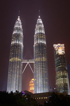 Kuala Lumpur, Malaysia - November 5, 2014: 88-storey Petronas Twin Towers - the main attraction of Kuala Lumpur in night scene.
