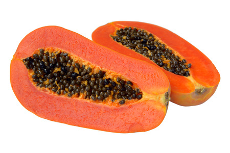 Halved papaya fruit isolated on white