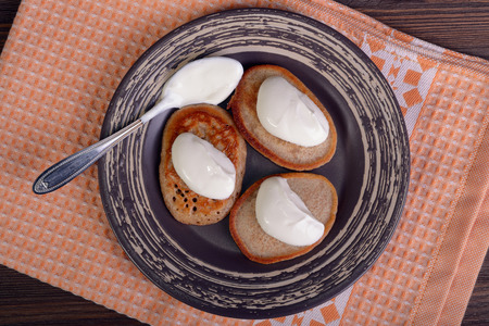 Fritters with sour cream, top view