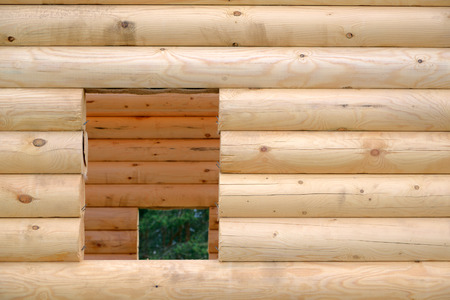 new construction: Wall with a window opening of the wooden house under construction Stock Photo