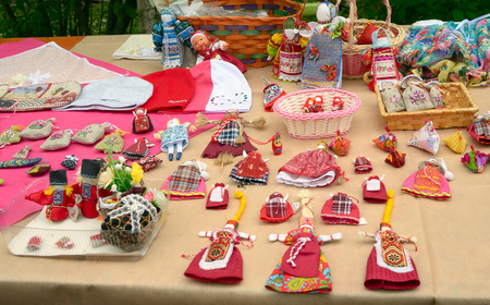fairs: St. Petersburg, Russia - May 22, 2016: Vintage handmade toys and dolls in folk style on the counter of the fairs.