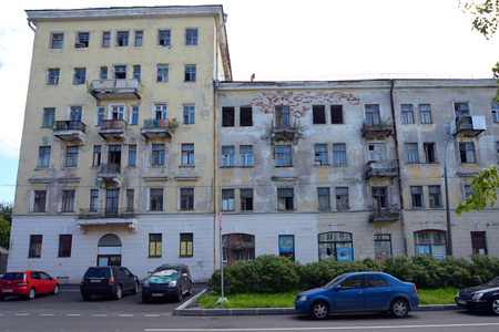 refurbishment: Kronstadt, Russia - July 14, 2016: Demolition multi-storey building on the street with parked cars