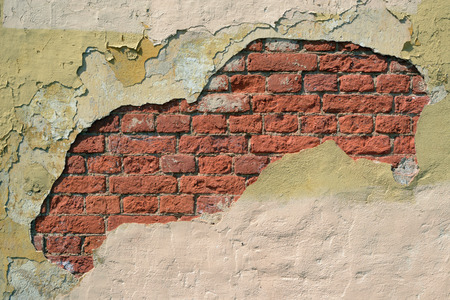 breakaway: Beautiful area breakaway plaster on brick wall Stock Photo