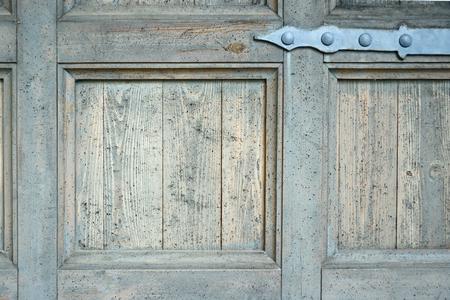 hinge: Old door hinge on old blue wooden door with weathered paint