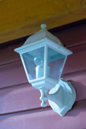 Old street lantern on wall