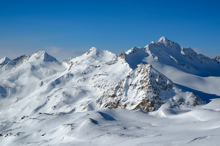 Snowy winter in the Caucasus mountains on a sunny day