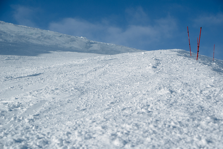 Empty ski slope with limiters, the bottom view
