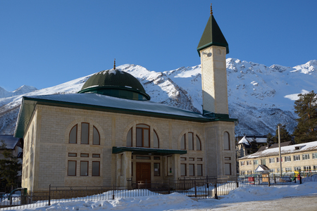 crescent: Mosque on the background of snow-capped mountains