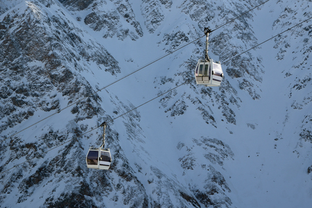 Mountain lift against snowy mountain, close up Stock Photo