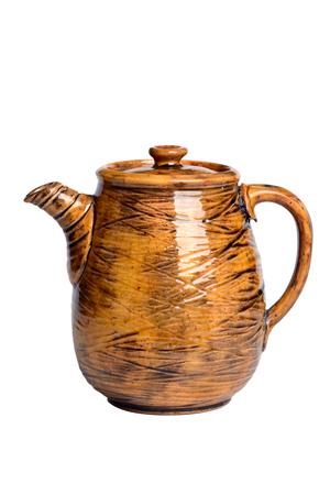 Yellow ceramic teapot isolated on white background