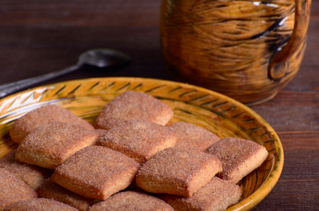 Cookies with cinnamon on a platter closeup Stock Photo