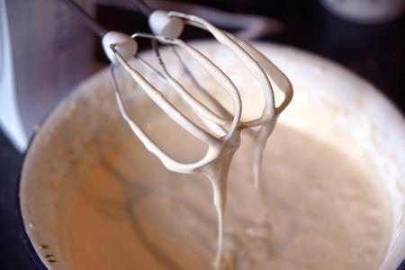 Electric mixer with beaten dough close up Stock Photo