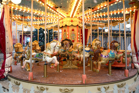 Horses on the festive carousel at the fair