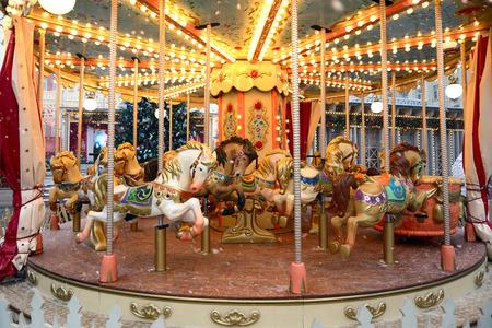 Horses on the festive carousel at the fair