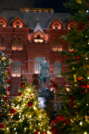 Moscow, Russia - January 08, 2018: Evening view of the building of the historical museum and the monument to Marshal Zhukov during the festivities.
