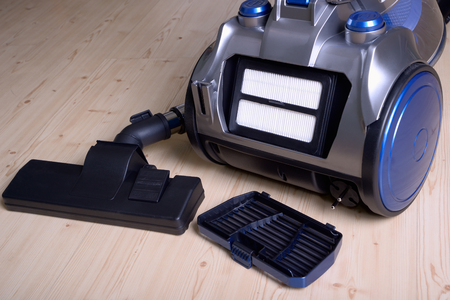 Clean air filter in the back of the vacuum cleaner close-up Stock Photo - 94898694