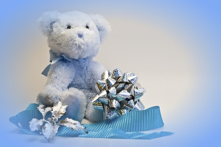 Blue teddy bear with bow and ribbon. photo