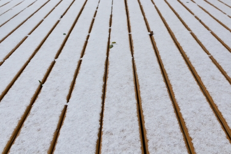 Fresh snow on wood deck boards. Background for your text. Stock fotó