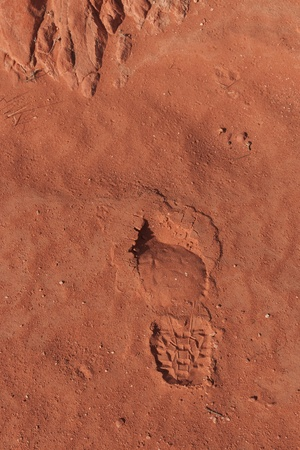 Imprint of the shoe on red stone sand in Valley of Fire, Nevada, USA photo
