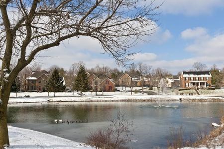 Winter city scene with a pond neighborhood recreation area  photo