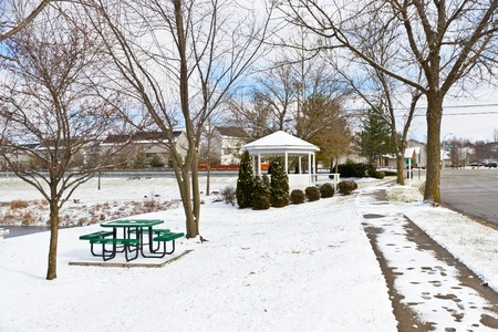 Winter city scene with a picnic table and gazebo at neighborhood recreation area  photo