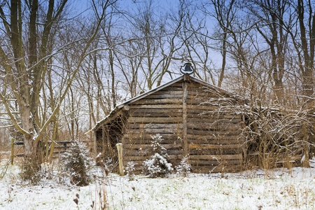 Winter country scene with old abandoned house  photo