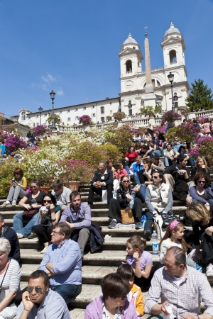 spanish steps: ROME - APRIL 25: People sitting on the Spanish Steps and enjoying the sun on April 25, 2012 in Rome, Italy. The Spanish Steps are one of the main sights for tourists in Rome and can become very crowded with tourists. Editorial