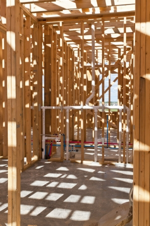 housebuilding: An interior view of a new home under construction with exposed wiring