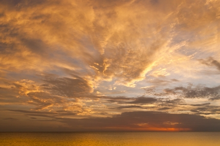 sky and clouds: Dramatic sunset sky with clouds over ocean  Stock Photo