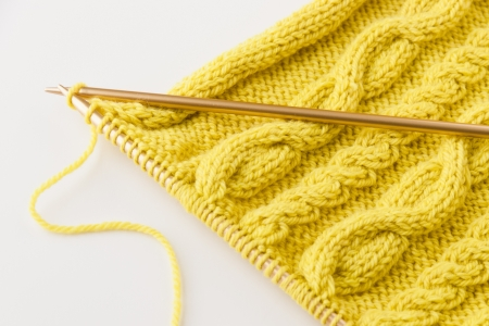 Knitting wool and knitting needles on light background  selective focus Stok Fotoğraf