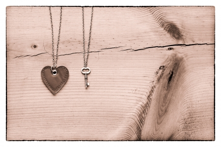 nostalgy: Vintage Valentine,  black and white heart and key on rustic cracked wood for valentines day background Stock Photo